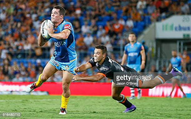 Daniel Mortimer of the Titans throws a pass during the round three NRL match between the Gold Coast Titans and the Wests Tigers at Cbus Super Stadium...