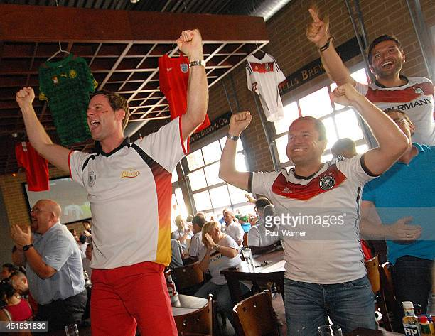 Daniel Muecke orginally of Duesseldorf Germany and Thilo Dappers orginally of Saarbruecken Germany celebrate while watching the Germany vs Algeria...