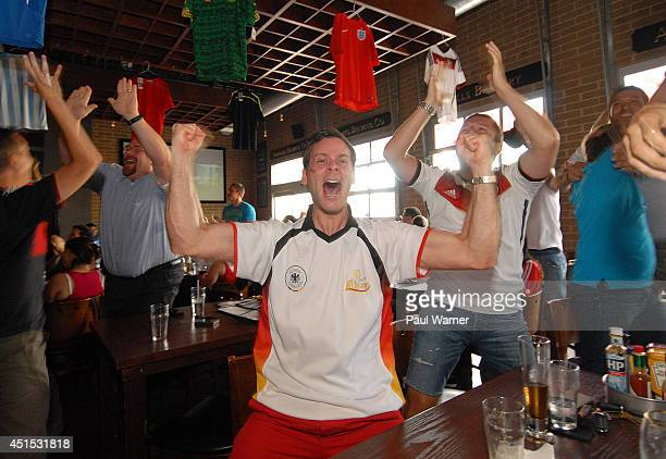 Daniel Muecke orginally of Duesseldorf Germany now living in Michigan celebrates while watching the Germany vs Algeria World Cup match at the Red Fox...