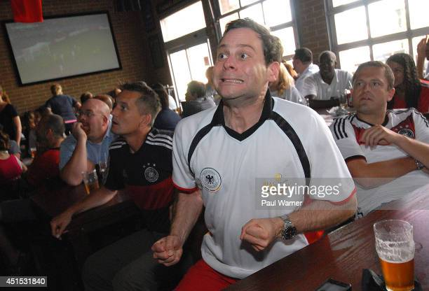 Daniel Muecke orginally of Duesseldorf Germany who now works in Rochester Hills MI watches the Germany vs Algeria World Cup match at the Red Fox...