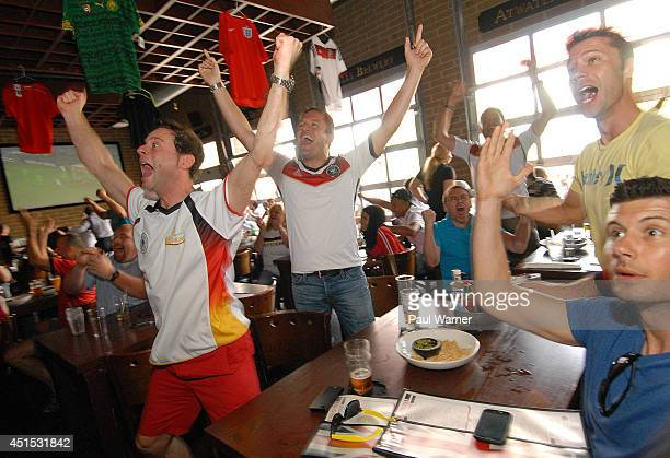 Daniel Muecke originally of Duesseldorf Germany and Thilo Dappers orginally of Saarbruecken Germany celebrate while watching the Germany vs Algeria...