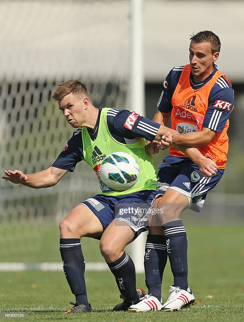 Daniel Mullen (L) and Spase Dilevski of the Victory compete for the ball during a Melbourne Victory A-League training session at Gosch's Paddock on February 14, 2013 in Melbourne, Australia.