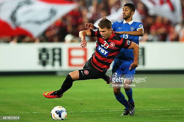 Daniel Mullen of the Wanderers competes with Salman Alfaraj of AlHilal during the Asian Champions League final match between the Western Sydney...