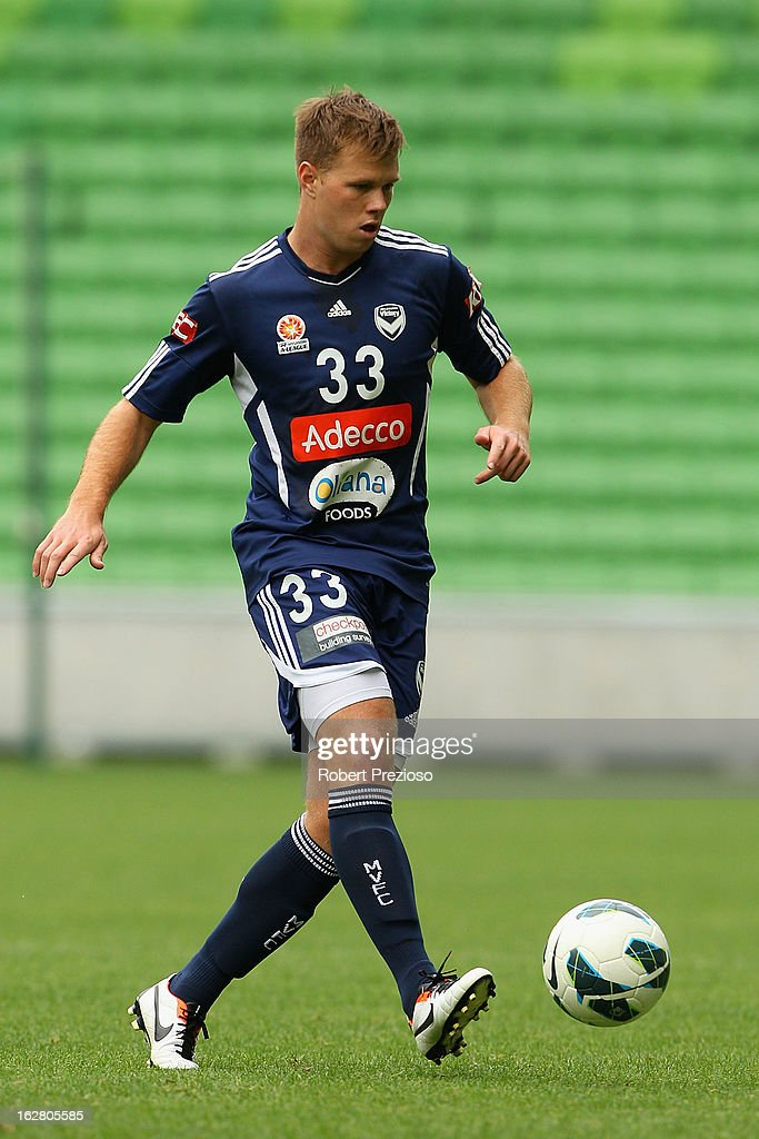 Daniel Mullen passes the ball during a Melbourne Victory A-League training session at AAMI Park on February 28, 2013 in Melbourne, Australia.