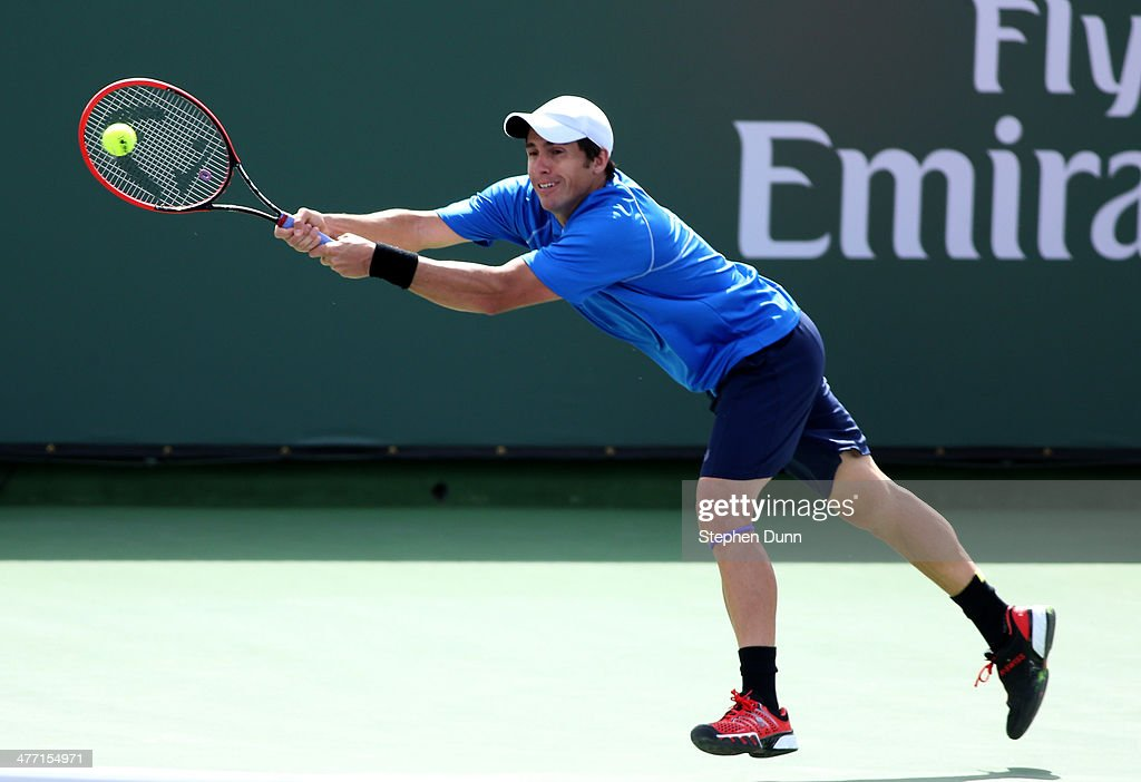 Daniel Munoz-De La Nava of Spain hits a return to Julien Benneteau of France during the BNP Paribas Open at Indian Wells Tennis Garden on March 7, 2014 in Indian Wells, California. Lepchenko won 6-3, 6-2.