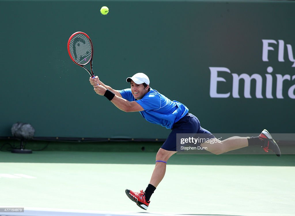 Daniel Munoz-De La Nava of Spain hits a return to Julien Benneteau of France during the BNP Paribas Open at Indian Wells Tennis Garden on March 7, 2014 in Indian Wells, California. Lepchenko won 6-3, 6-2.