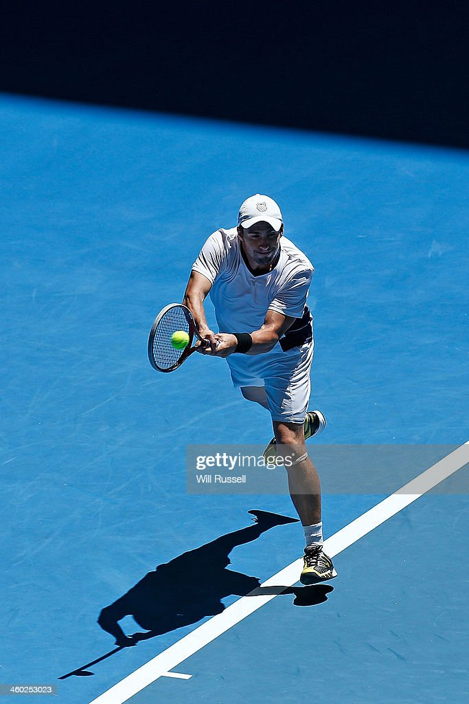 Daniel Munoz-De La Nava of Spain plays a backhand in the men's singles match against Jo-Wilfried Tsonga of France during day seven of the Hopman Cup at Perth Arena on January 3, 2014 in Perth, Australia.