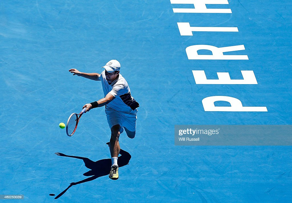 Daniel Munoz-De La Nava of Spain plays a forehand in the men's singles match against Jo-Wilfried Tsonga of France during day seven of the Hopman Cup at Perth Arena on January 3, 2014 in Perth, Australia.
