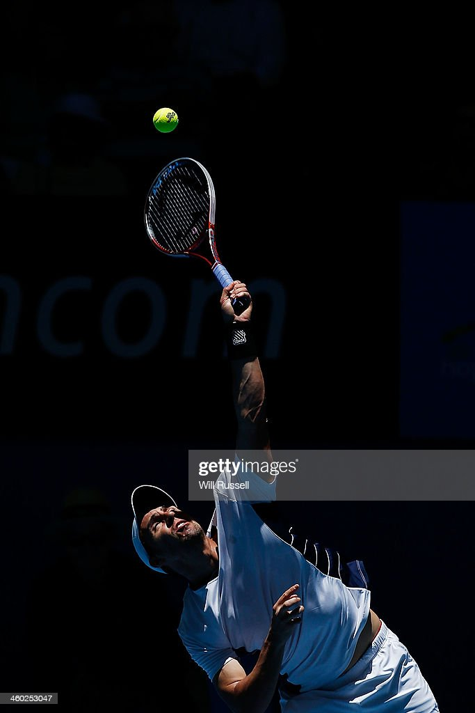 Daniel Munoz-De La Nava of Spain serves to Jo-Wilfried Tsonga of France in the men's singles match during day seven of the Hopman Cup at Perth Arena on January 3, 2014 in Perth, Australia.