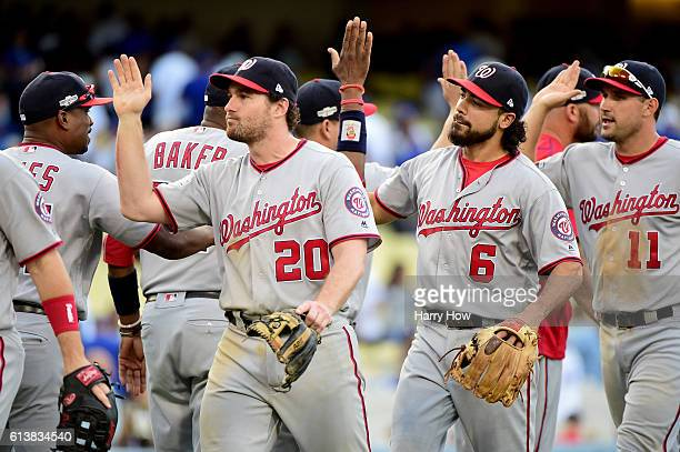 Daniel Murphy and Anthony Rendon of the Washington Nationals celebrate after the final out as the Nationals defeat the Los Angeles Dodgers 83 in game...