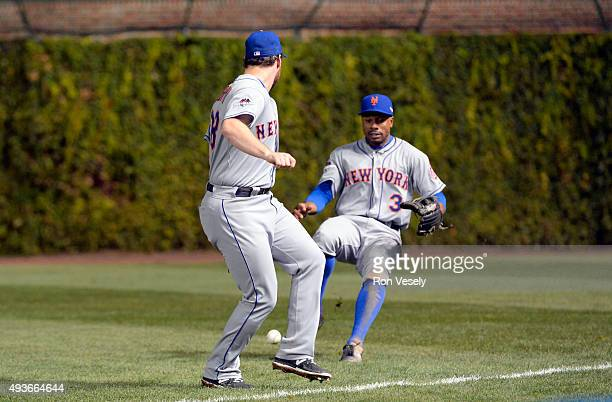 Daniel Murphy and Curtis Granderson of the New York Mets fail to make the catch in the bottom of the fifth inning of Game 4 of the NLCS against the...
