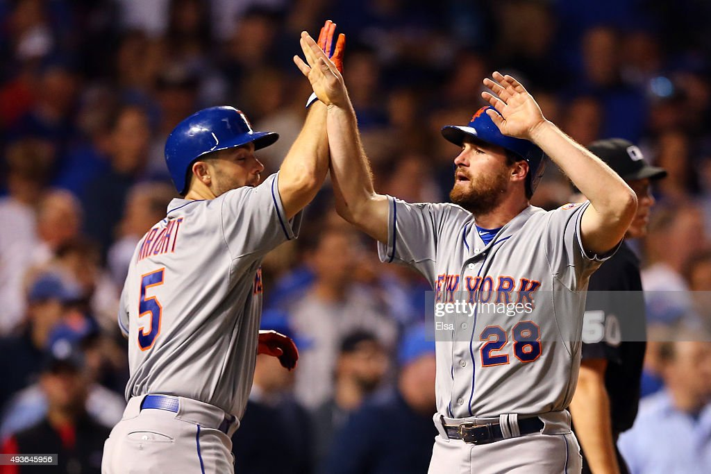 Daniel Murphy and David Wright of the New York Mets celebrate after scoring off of a double hit by Lucas Duda of the New York Mets in the second...