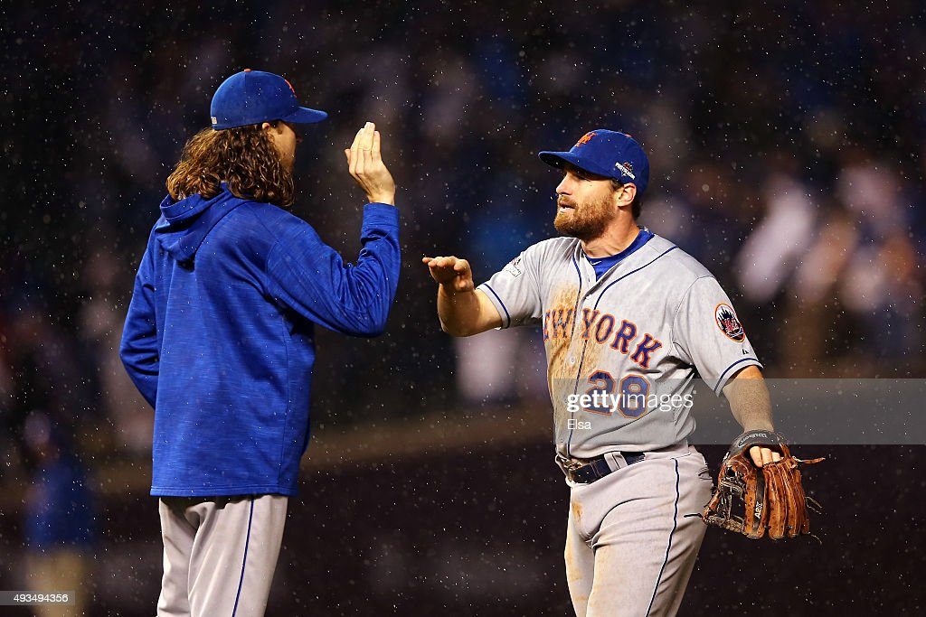 Daniel Murphy #28 and Jacob deGrom #48 of the New York Mets celebrate after defeating the Chicago Cubs in game three of the 2015 MLB National League Championship Series at Wrigley Field on October 20, 2015 in Chicago, Illinois. The Mets defeated the Cubs with a score of 5 to 2.