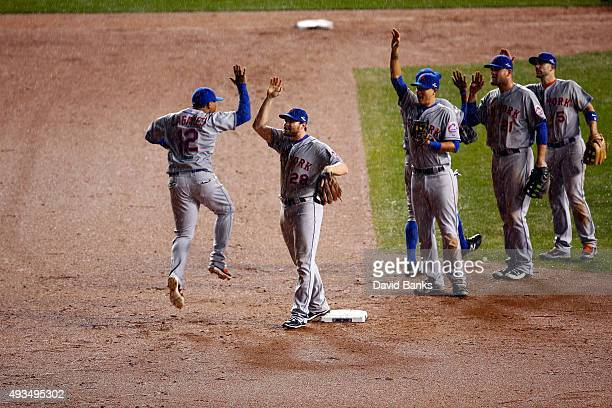 Daniel Murphy and Juan Lagares of the New York Mets celebrate after defeating the Chicago Cubs in game three of the 2015 MLB National League...