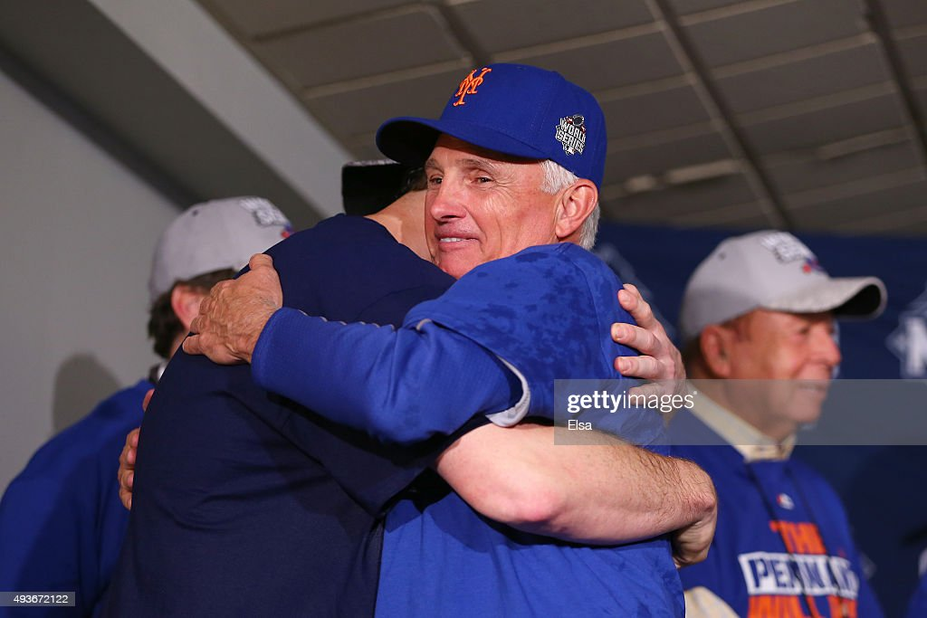 Daniel Murphy #28 and Manager Terry Collins #10 of the New York Mets hug after defeating the Chicago Cubs in game four of the 2015 MLB National League Championship Series at Wrigley Field on October 21, 2015 in Chicago, Illinois. The Mets defeated the Cubs with a score of 8 to 3 to sweep the Championship Series.