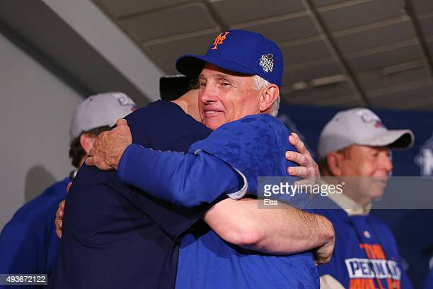 Daniel Murphy and Manager Terry Collins of the New York Mets hug after defeating the Chicago Cubs in game four of the 2015 MLB National League...