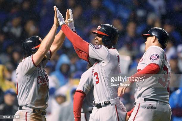 Daniel Murphy and Michael A Taylor of the Washington Nationals celebrate after Taylor hit a grand slam in the eighth inning during game four of the...