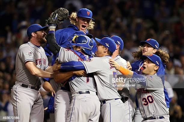 Daniel Murphy and Noah Syndergaard of the New York Mets celebrates with his teammates after defeating the Chicago Cubs in game four of the 2015 MLB...