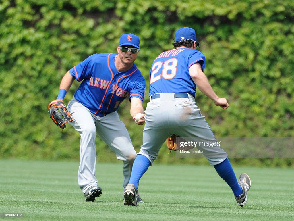 Daniel Murphy #28 and <a gi-track='captionPersonalityLinkClicked' href=/galleries/search?phrase=Rick+Ankiel&family=editorial&specificpeople=803371 ng-click='$event.stopPropagation()'>Rick Ankiel</a> #16 of the New York Mets let a single drop in between them during the eighth inning on May 18, 2013 at Wrigley Field in Chicago, Illinois. The Chicago Cubs defeated New York Mets 8-2.