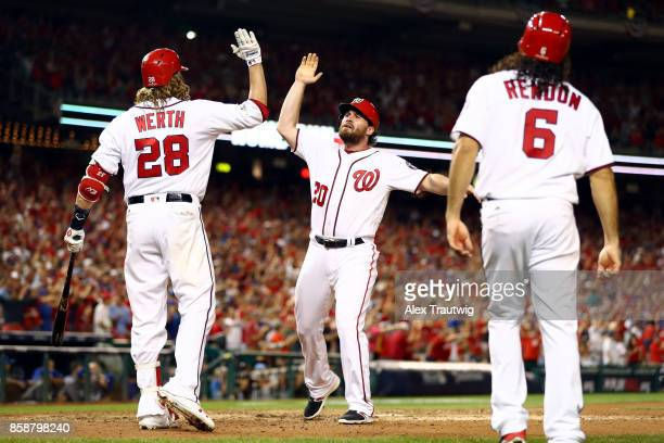 Daniel Murphy celebrates with Jayson Werth after Ryan Zimmerman of the Washington Nationals hit a threerun home run in the eighth inning during Game...