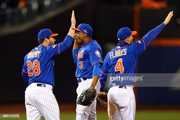 Daniel Murphy Curtis Granderson and Wilmer Flores of the New York Mets celebrates after defeating the Chicago Cubs by a score outfield 42 to win game...