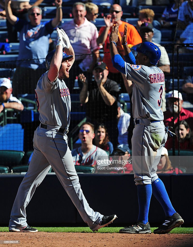 Daniel Murphy is congratulated by Curtis Granderson of the New York Mets after hitting a threerun ninth inning home run against the Atlanta Braves at...