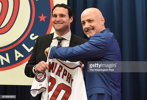 Daniel Murphy is introduced by GM Mike Rizzo during a press conference to introduce new Nationals infielder on January 7 2016 in Washington DC