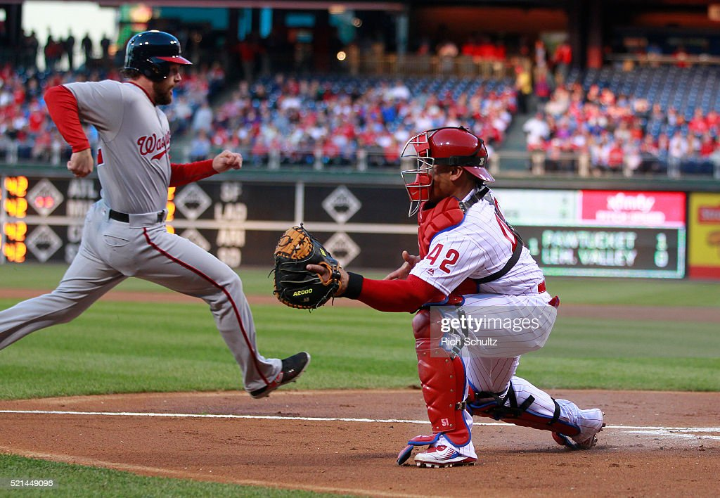 <a gi-track='captionPersonalityLinkClicked' href=/galleries/search?phrase=Daniel+Murphy+-+Baseball+Player&family=editorial&specificpeople=8610809 ng-click='$event.stopPropagation()'>Daniel Murphy</a>, left, of the Washington Nationals scores on a bases loaded double by Jayson Werth as catcher <a gi-track='captionPersonalityLinkClicked' href=/galleries/search?phrase=Carlos+Ruiz+-+Baseball+Player&family=editorial&specificpeople=216605 ng-click='$event.stopPropagation()'>Carlos Ruiz</a>, right, of the Philadelphia Phillies waits for the throw during the first inning of an MLB game at Citizens Bank Park on April 15, 2016 in Philadelphia, Pennsylvania. All players are wearing #42 in honor of Jackie Robinson.