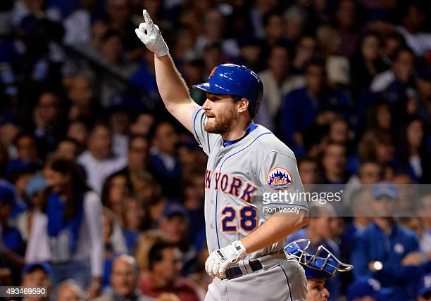 Daniel Murphy of the New York Mets celebrates after hitting a home run in the top of the third inning of Game 3 of the NLCS against the Chicago Cubs...