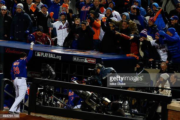 Daniel Murphy of the New York Mets celebrates after hitting a two run home run in the first inning against Jake Arrieta of the Chicago Cubs during...
