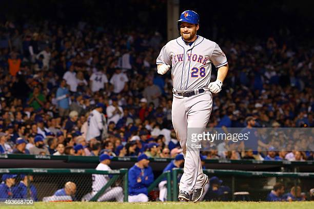 Daniel Murphy of the New York Mets celebrates after hitting a two run home run in the eighth inning against Pedro Strop of the Chicago Cubs during...