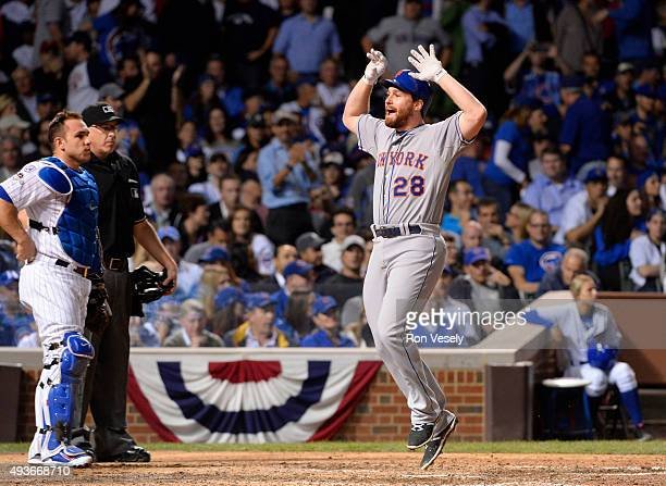 Daniel Murphy of the New York Mets celebrates after hitting a tworun home run in the top of the eighth inning of Game 4 of the NLCS against the...