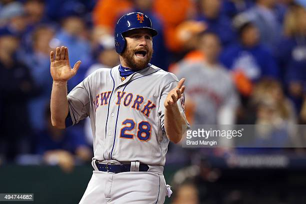 Daniel Murphy of the New York Mets celebrates after scoring in the fourth inning off a hit by Lucas Duda against the Kansas City Royals during Game 2...