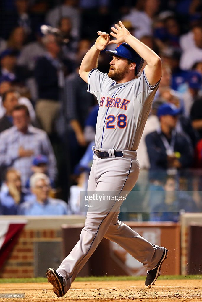 Daniel Murphy of the New York Mets celebrates after scoring off of a double hit by Lucas Duda of the New York Mets in the second inning against...