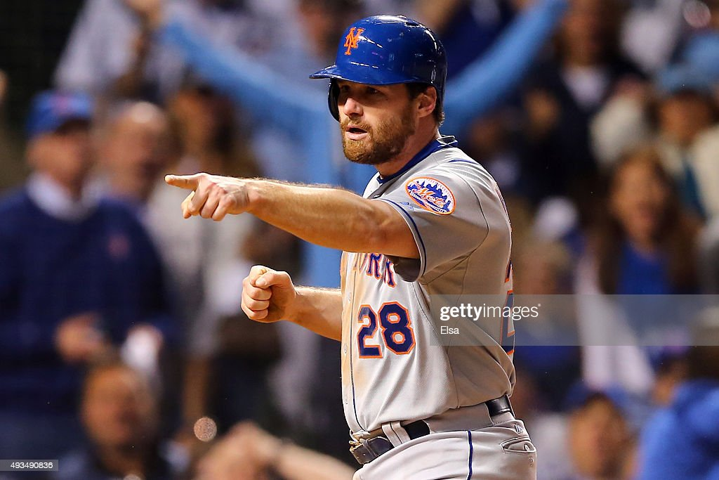 Daniel Murphy #28 of the New York Mets celebrates after scoring off of an RBI ground out hit by Lucas Duda #21 in the seventh inning against Justin Grimm #52 of the Chicago Cubs during game three of the 2015 MLB National League Championship Series at Wrigley Field on October 20, 2015 in Chicago, Illinois.