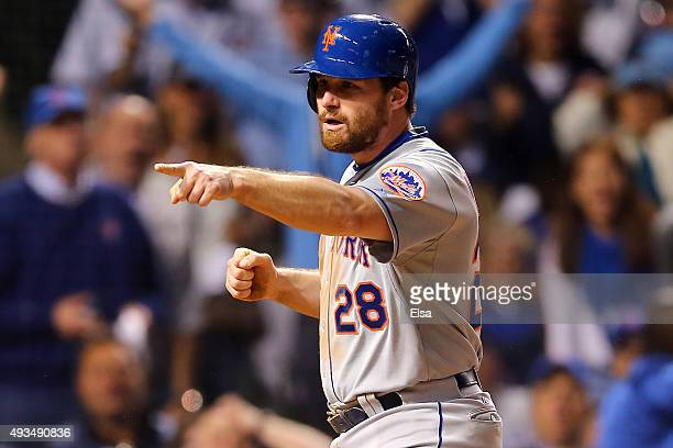 Daniel Murphy of the New York Mets celebrates after scoring off of an RBI ground out hit by Lucas Duda in the seventh inning against Justin Grimm of...