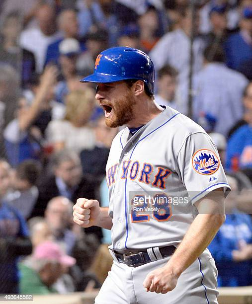 Daniel Murphy of the New York Mets celebrates after scoring on Lucas Duda's twoRBI double in the second inning of Game 4 of the NLCS against the...
