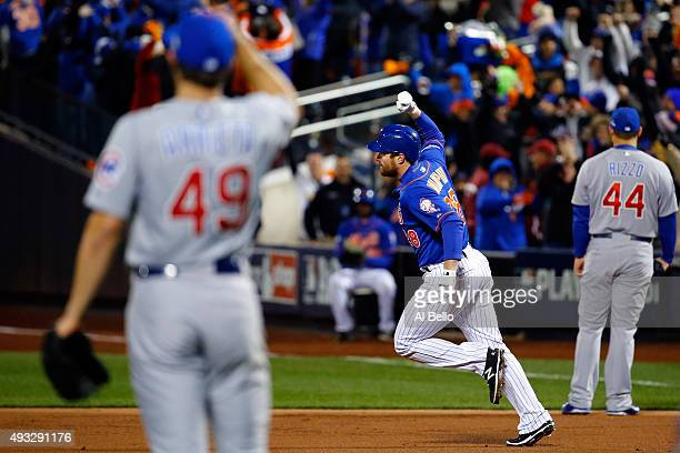 Daniel Murphy of the New York Mets celebrates as he rounds the bases after hitting a two run home run in the first inning against Jake Arrieta of the...