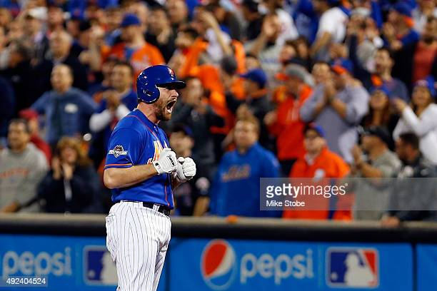 Daniel Murphy of the New York Mets celebrates his single in the fourth inning to score in Juan Lagares against Alex Wood of the Los Angeles Dodgers...