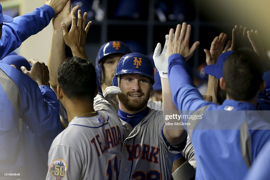 Daniel Murphy #28 of the New York Mets celebrates in the dugout after hitting a two-run home run in the top of the second inning against the Milwaukee Brewers at Miller Park on September 14, 2012 in Milwaukee, Wisconsin.