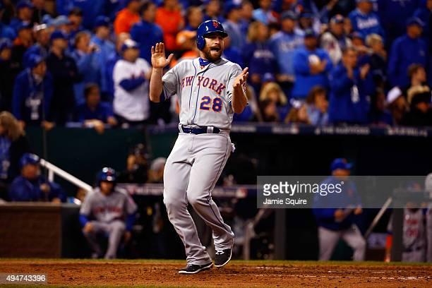 Daniel Murphy of the New York Mets celebrates scoring a run on an RBI single hit by Lucas Duda of the New York Mets in the fourth inning against the...