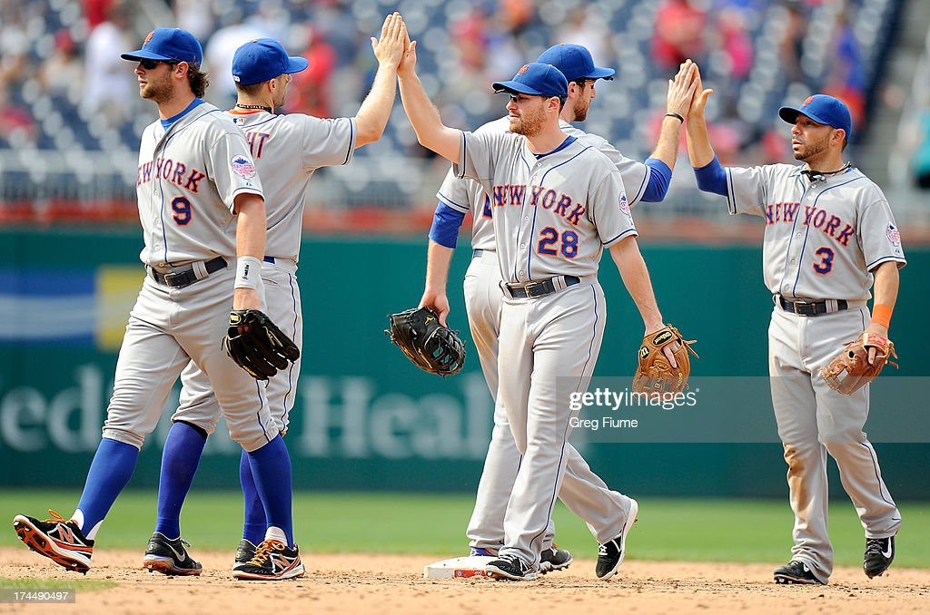 Daniel Murphy #28 of the New York Mets celebrates with <a gi-track='captionPersonalityLinkClicked' href=/galleries/search?phrase=David+Wright+-+Baseball+Player&family=editorial&specificpeople=209172 ng-click='$event.stopPropagation()'>David Wright</a> #5 after a 11-0 victory against the Washington Nationals at Nationals Park on July 26, 2013 in Washington, DC.