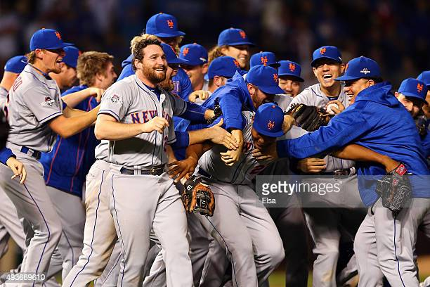 Daniel Murphy of the New York Mets celebrates with his teammates after defeating the Chicago Cubs in game four of the 2015 MLB National League...