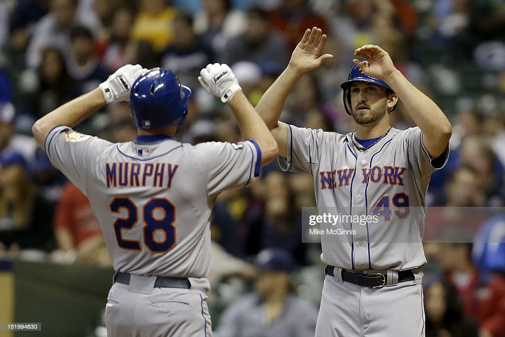 Daniel Murphy #28 of the New York Mets celebrates with Jonathan Niese #49 after hitting a two-run home run in the top of the second inning against the Milwaukee Brewers at Miller Park on September 14, 2012 in Milwaukee, Wisconsin.