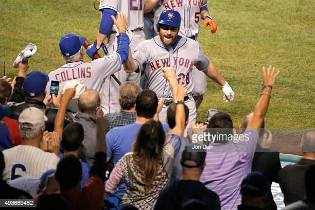 Daniel Murphy of the New York Mets celebrates with manager Terry Collins after hitting a two run home run in the eighth inning against Pedro Strop of...