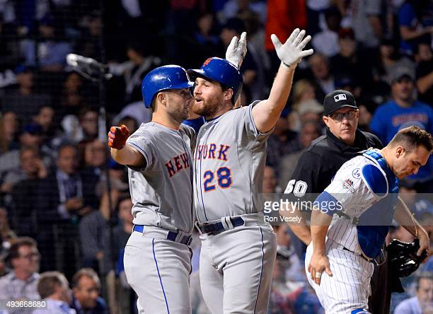 Daniel Murphy of the New York Mets celebrates with teammate David Wright after hitting a tworun home run in the top of the eighth inning of Game 4 of...
