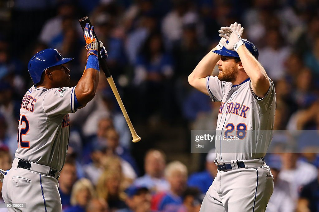 Daniel Murphy of the New York Mets celebrates with Yoenis Cespedes after hitting a solo home run in the third inning against Kyle Hendricks of the...