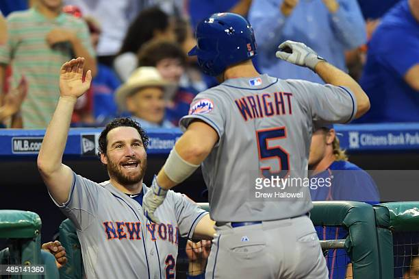 Daniel Murphy of the New York Mets congratulates teammate David Wright on a home run in the second inning against the Philadelphia Phillies at...