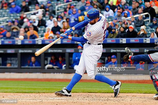 Daniel Murphy of the New York Mets connects on a seventh inning RBI base hit against the Atlanta Braves at Citi Field on April 23 2015 in the...