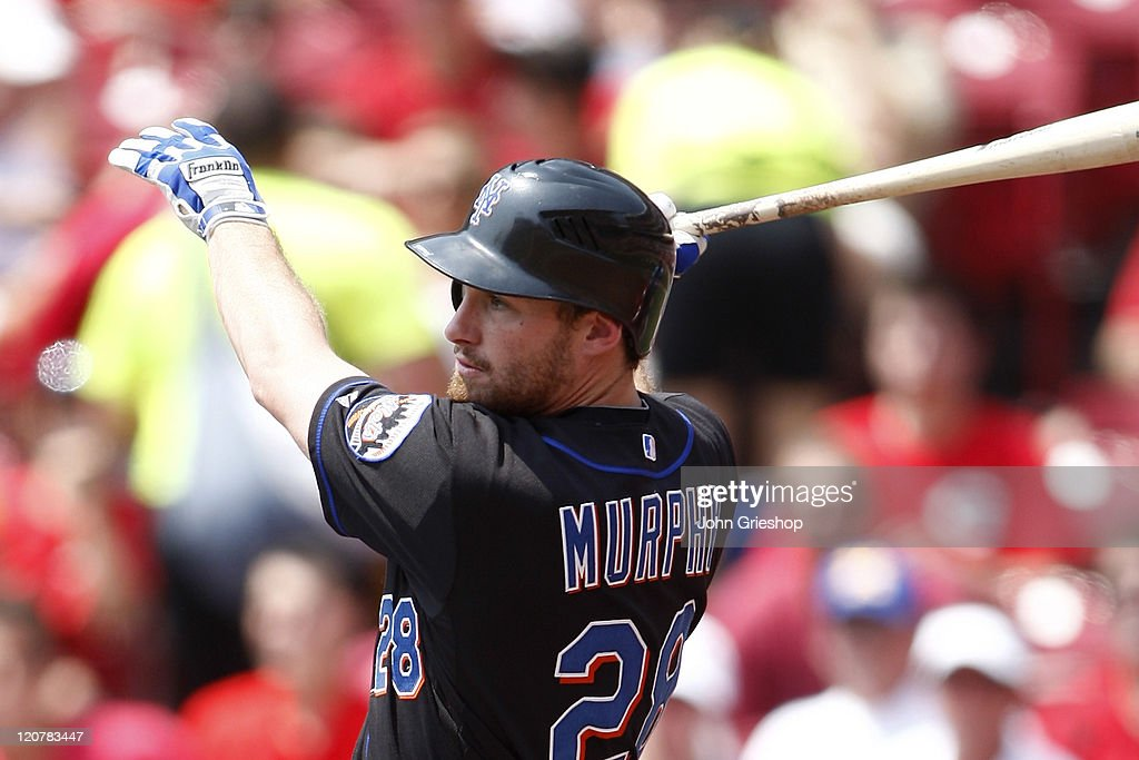 Daniel Murphy #28 of the New York Mets connects with a pitch during the game against the Cincinnati Reds at Great American Ballpark July 28, 2011 in Cincinnati, Ohio.